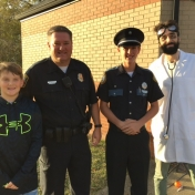 Officer Burton and friends at 2016 Trick or Treat Night